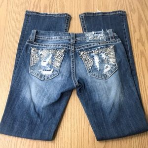 Miss Me Signature Boot Heavily Distressed Jeans